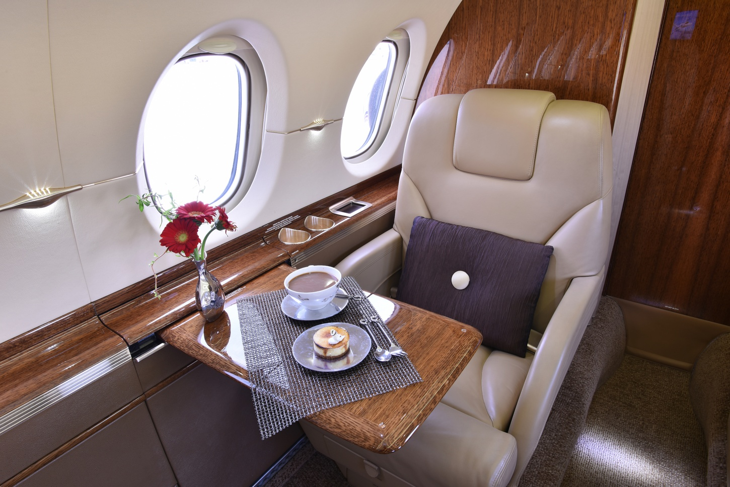 Luxurious seat with breakfast on the table with a coffee cup in the 2012 Hawker 900XP S/N HA-0209 jet on Freestream