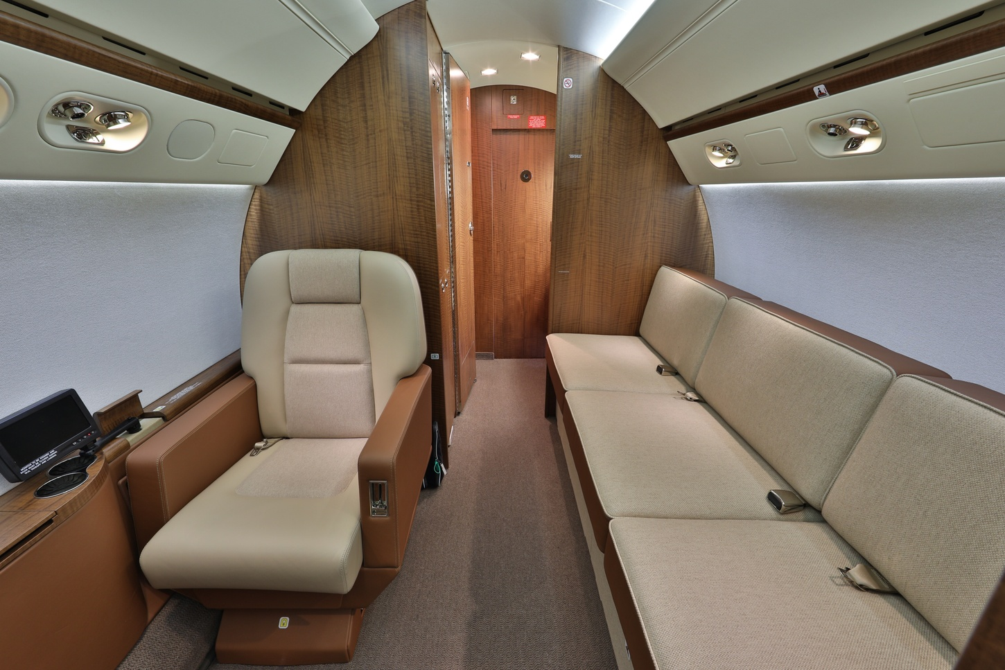 Luxurious interior on jet with leather single chair and elongated couch on Freestream