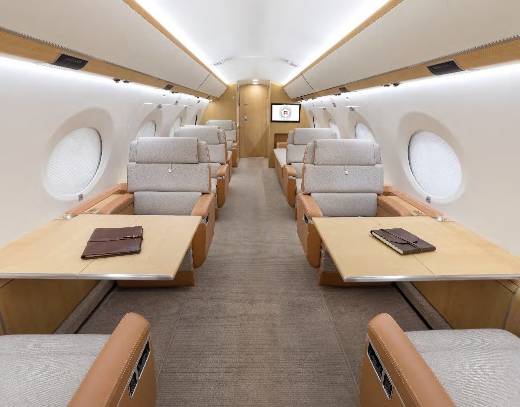 Luxurious seating and tables in cabin of the 2018 Gulfstream G650 S/N 6312 jet on Freestream