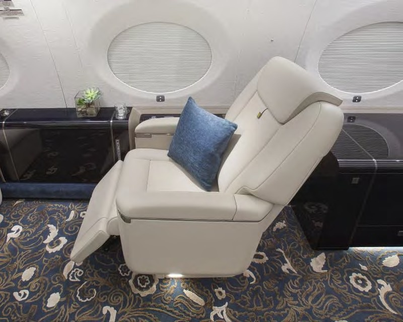 Reclining white comfy chair on jet