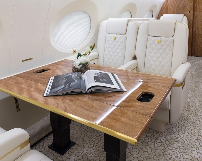 Open book on the table of a 2018 Gulfstream G650ER jet on Freestream